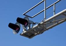 Overhead Railroad Crossing. Flashing under blue sky Stock Photos