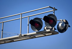 Overhead Railroad Crossing. Flashing under blue sky Royalty Free Stock Images