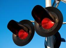 Overhead Railroad Crossing. Flashing under blue sky Stock Image