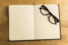 Overhead of reading glasses with notebook Royalty Free Stock Photography