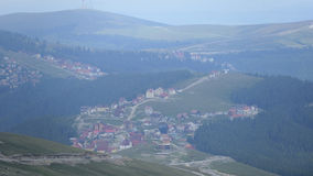 Overhead Runcu Village, Romania. Overhead view of Runcu village in Romania nestled in valley on overcast day Royalty Free Stock Images