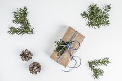 OVERHEAD RUSTIC HOMEMADE PRESENT BOX. CHRISTMAS ORNAMENTS ON WHITE BACKGROUND. MERRY CHRISTMAS. DECORATIVE ELEMENTS OVERHEAD PHOTO. BEAUTYFUL ORNAMENT TOOLS royalty free stock photo