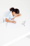 Overhead schoolgirl studying Stock Photography