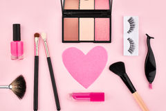 Overhead set, fashion woman essentials cosmetics. Overhead Still life, fashion woman essentials cosmetics. Beauty makeup accessories. Lipstick, brushes Stock Photos