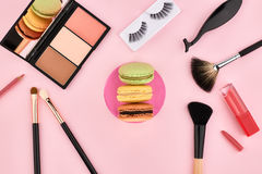 Overhead set, fashion woman essentials cosmetics. Overhead Still life, fashion woman essentials cosmetics. Beauty makeup accessories.Macarons french dessert Stock Photos