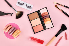 Overhead set, fashion woman essentials cosmetics. Overhead Still life, fashion woman essentials cosmetics. Beauty makeup accessories.Macarons french dessert Royalty Free Stock Photo