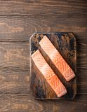 Fresh raw salmon fillet, flat lay. Overhead shoot of fresh raw salmon fillet. Old wooden background. Top view. Copy space Stock Image