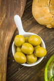Overhead shoot of green olives on rustic wooden Stock Photo