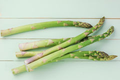 Overhead shot of asparagus. On woody background royalty free stock image