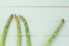 Overhead shot of asparagus. On woody background royalty free stock images