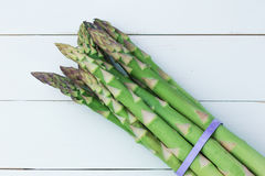 Overhead shot of asparagus. On woody background stock photography