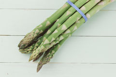 Overhead shot of asparagus. On woody background stock image