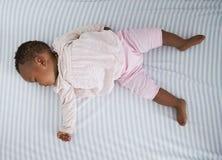 Overhead Shot Of Baby Girl Sleeping In Nursery Cot Stock Photos