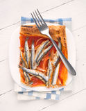 Overhead shot of baked sardines ration on puff pastry. With fork Stock Images