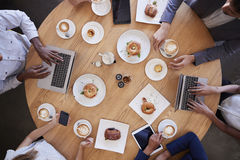 Overhead Shot Of Businesspeople Meeting In Coffee Shop royalty free stock photo