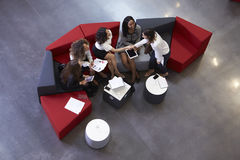 Overhead Shot Of Businesswomen Meeting In Lobby Of Office Stock Images