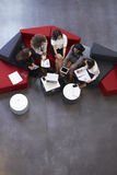 Overhead Shot Of Businesswomen Meeting In Lobby Of Office Royalty Free Stock Photo