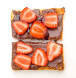 Overhead shot of chocolate toast with sliced strawberries Royalty Free Stock Photos