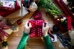 Overhead shot of Christmas presents and wrapping papers Royalty Free Stock Images