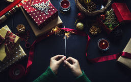 Overhead shot of Christmas presents and wrapping papers Stock Photography