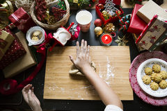 Overhead shot of Christmas presents and wrapping papers Royalty Free Stock Photos