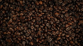 Overhead Shot Of Coffee Beans Pouring Into Pile