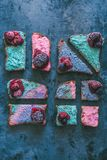 Overhead shot of colorful delicious fruit sandwiches on a rustic grungy blue background stock photos