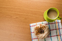 Overhead shot of doughnut and coffee Royalty Free Stock Photos