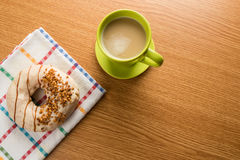 Overhead shot of doughnut and coffee Royalty Free Stock Image