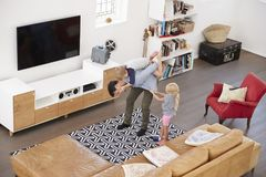 Overhead Shot Of Father Playing With Children In Lounge Royalty Free Stock Images