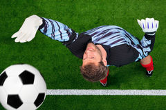 Overhead shot of a goalkeeper missing the ball. royalty free stock photos