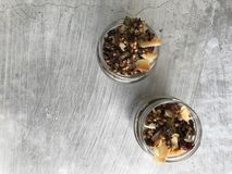 Overhead shot of granola in two jars stock photo