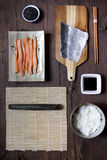 Overhead shot of ingredients for preparing sushi on wooden table Stock Images