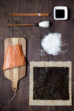 Overhead shot of ingredients for sushi on wooden table Stock Photo