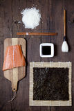 Overhead shot of ingredients for sushi on wooden table Stock Photos
