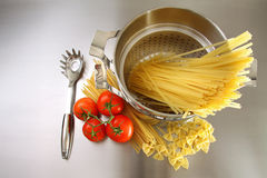 Overhead shot of pasta, tomatoes and pot Royalty Free Stock Photo