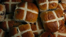 Hot cross buns pile rotating. Overhead shot of plate of hot cross buns turning slowly stock footage