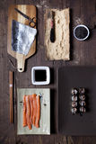 Overhead shot of prepared hosomaki sushi and ingredients on table Royalty Free Stock Images