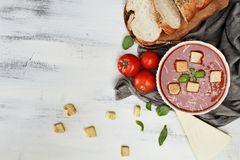 Overhead Shot of Tomato Soup. Hot tomato soup with Parmesan cheese and basil leaves with Croutons. Image shot from above in flat lay style Royalty Free Stock Photos
