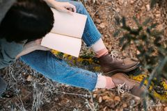 Overhead shot of woman in boots with book royalty free stock photos