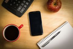 Overhead of smartphone with pen. On a desk Royalty Free Stock Photos