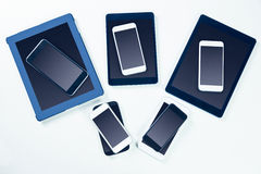 Overhead of smartphones and tablets Royalty Free Stock Photography