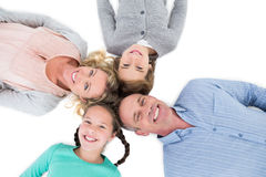 Overhead of smiling family lying together in a circle Stock Photo