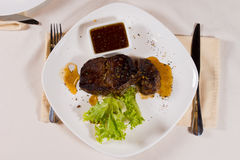 Overhead of Steak on Plate with Garnish Stock Image