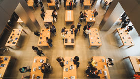 Overhead of tables with people Royalty Free Stock Photos