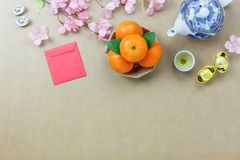 Overhead of top decorations Chinese New Year festive background. Concept.Mix variety essential accessory on modern grunge brown table house office desk.Other royalty free stock images