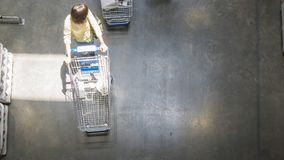 Overhead top view of people walk with shopping trolley cart at t royalty free stock photos