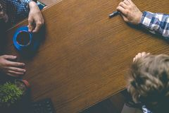 Overhead top view of workers hands on the office table with a copy space royalty free stock images