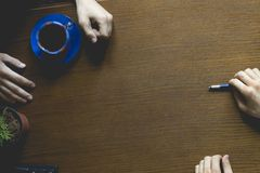 Overhead top view of workers hands on the office table with a copy space royalty free stock image