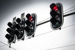 Overhead traffic lights on red on overcast day Stock Image